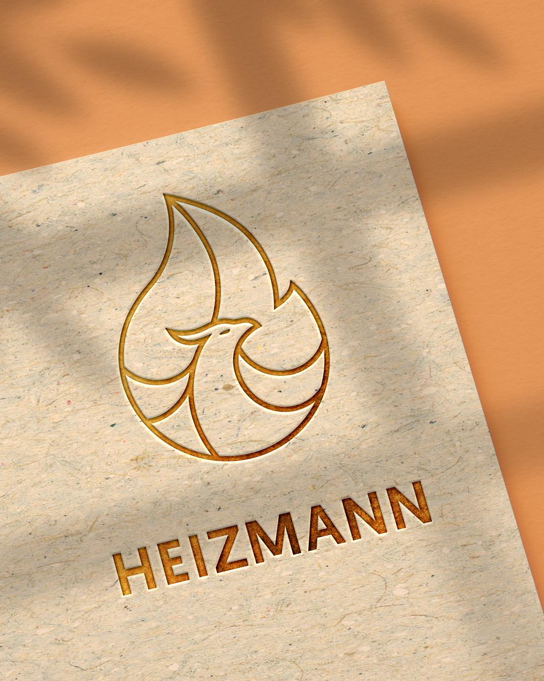 Logo d'un phénix géométrique dans une flamme